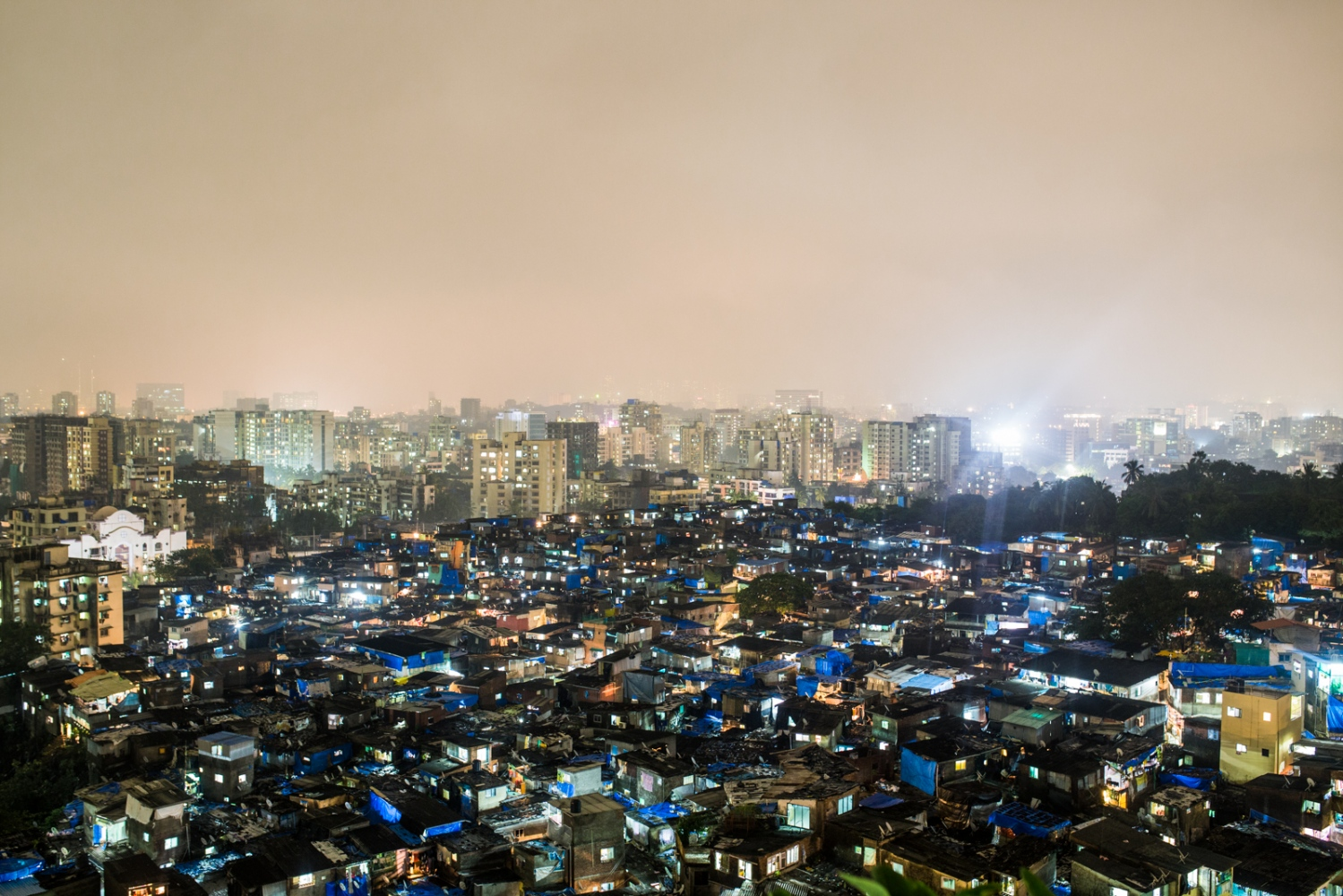 Slums of Mumbai, India. Energy puts on an incredible show at night and reminds you that millions of people are alive, surviving, and going through the daily grind. So much of our energy is sourced from fossil fuels that are responsible for vast amounts of air pollution and CO2 emissions that cause climate change. However, fossil fuels have been and still are responsible for the development of billions of people worldwide. There is no other source of concentrated energy that is so cheap, accessible, and transportable. This is why it is so important that global leaders take into consideration multiple solutions and adaptations to wean our society off our fossil fuel addiction. If people are to be lifted out of poverty, alternative energy sources need to be just as cheap and accessible. Subsidies play a large part in this game, and there is a dire need to shift subsidies away from fossil fuels to clean energy sources. Energy is a central factor to the betterment of people's lives. Without it nothing is possible.