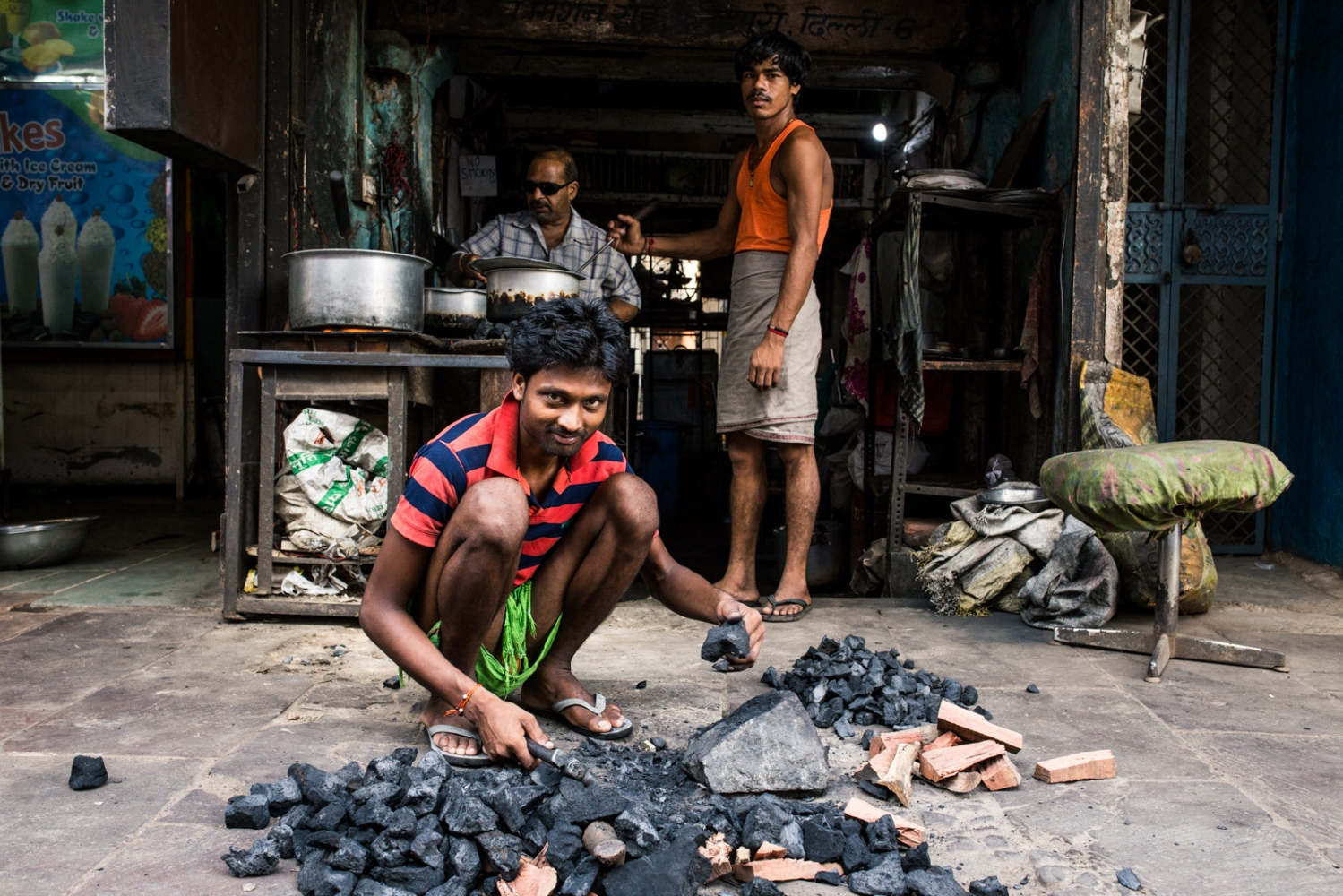 """Man in New Delhi, India, breaks up coal on the side fo the street to use as fuel for the fires so their business can stay open. Recently, environmental policy expert, Michael Shellenberger, gave a TED talk and was quoted saying, """"We're not in a clean energy revolution; we're in a clean energy crisis."""" He isn't wrong. Despite all the amazing developments and stories surrounding renewables, such as solar and wind, data paints a rather sobering message. According to the International Energy Agency's data, as of 2013, coal still accounts for 41% of global electricity generation and is expected to increase with the development of nations such as India and China. Solar, wind, geothermal, etc. account for 5.7% of global electricity supply. If we include clean electricity sources such as nuclear and hydro - the clean sources of energy account for 32.6% Despite this, fossil fuels, such as coal, oil, and natural gas, used to produce electricity far outpaces clean electricity and are expected to rise with increases in population and living standards."""