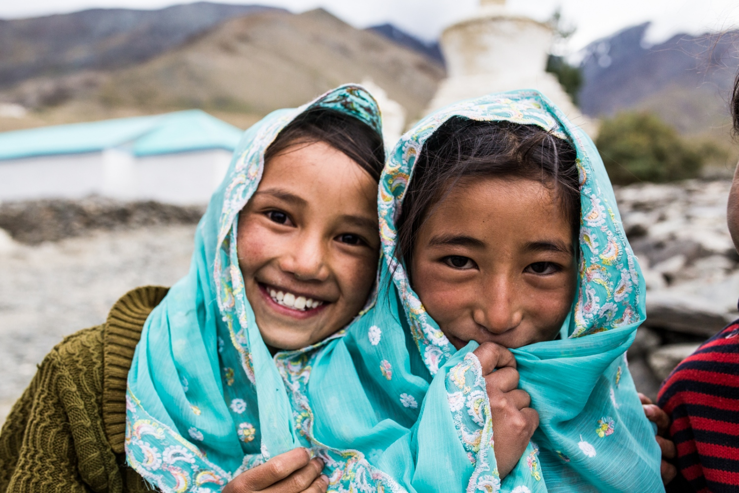 Two young girls of Kumik pose for a portrait. The younger generations of Kumik face an unknown future.
