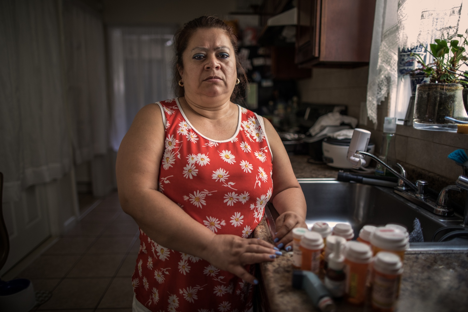 "Elisabeth Pelaez, 50, Colombian. She cleaned debris for a month and sleeps with a breathing machine. ""The lawyers tell us that we have to wait for compensation but we have been waiting for many years. I have a partial disability and can no longer work as I did before."""