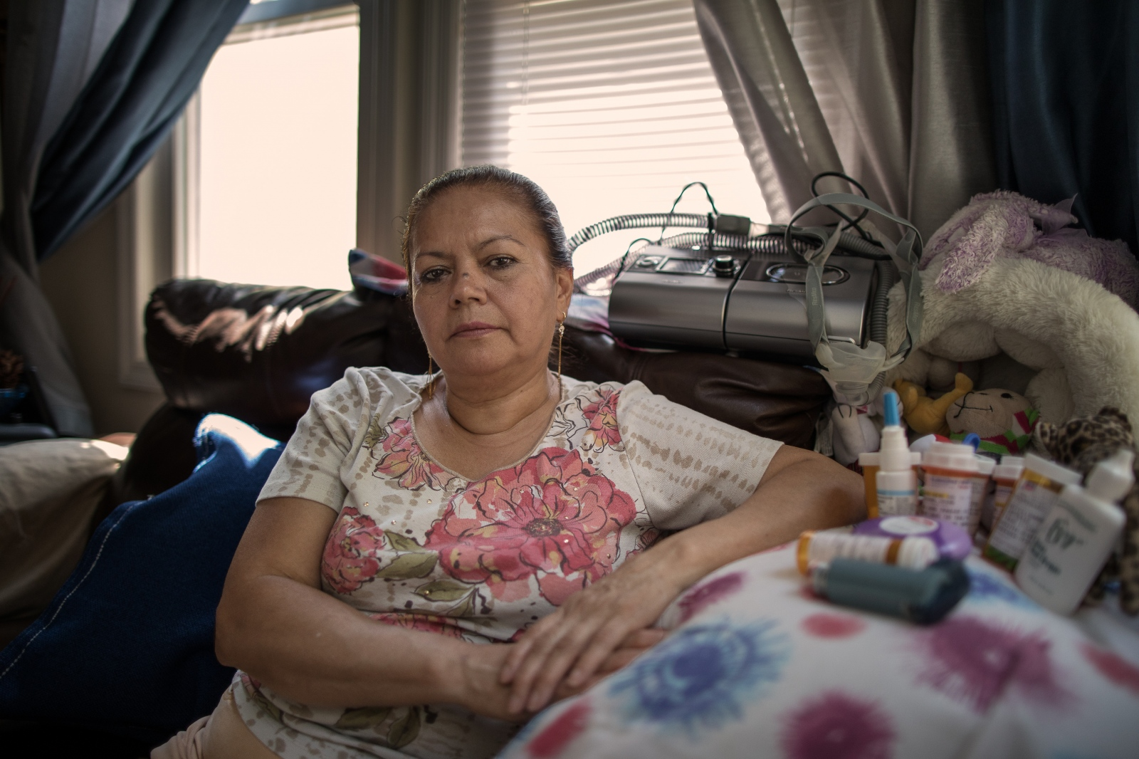 "Martha Rodriguez, 58, Colombian. Worked cleaning after 9/11 for two months. ""Every day I feel worse and I have a hard time working. I sleep attached to a breathing machine and this is one of the reasons why my marriage failed."""