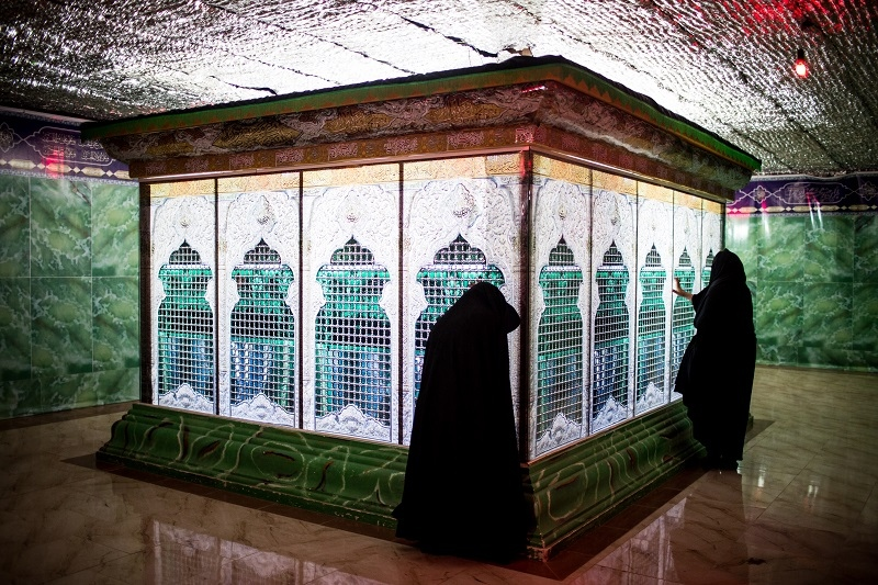 The holy shrine of Imam Hossein (AS) is in Karbala city in Iraq. Every year, a large number of Iranians visit Karbala on Ashoura and Arba'een Days and visit his holy shrine. Given the huge love of people in Noushabad city of Kashan in Central Iran, a model of Imam Hossein (AS)'s shrine has been built and people visit it. Women are visiting the model of Imam Hossein (AS) shrine. ( kashan/noosh abad)