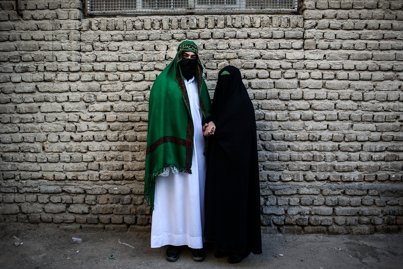 "The portrait of a young couple on Ashoura Day and during ""ChehelManbaran"" ceremony. (Lorestan / khorram abad)."