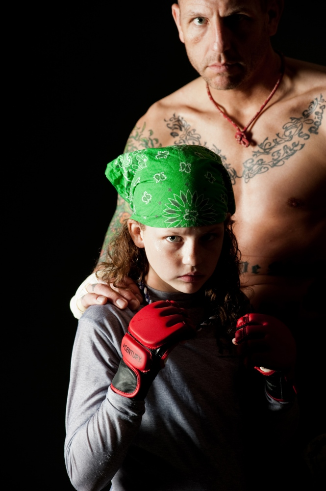 """A portrait of 12-year-old MMA fighter Madeline Green and her father, MMA fighter """"Mean"""" Mike Green. Photographed for the Riverfront Times"""
