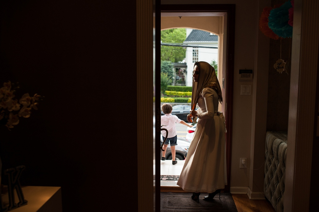 Yusra Udayni prepares to leave her home in the Brooklyn neighborhood of Bay Ridge for Eid al-Fitr prayer Sunday, June 25, 2017.