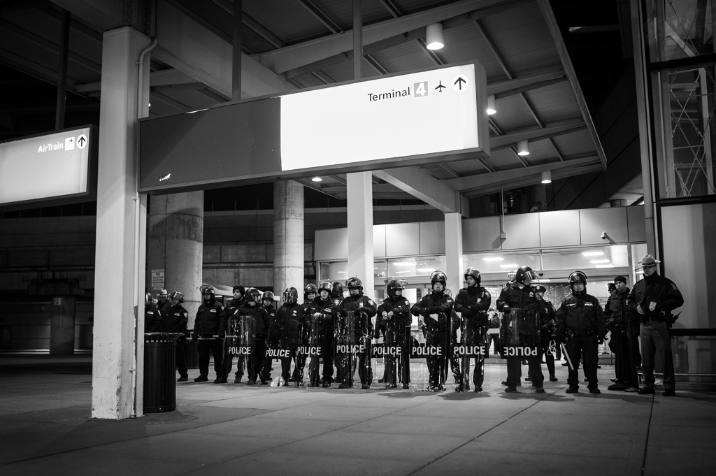 A line of police separate protestors from Terminal 4 at John F. Kennedy International Airport in New York City Jan. 28, 2017. President Donald Trump signed an executive order restricting immigration from Syria and six other Middle Eastern and African countries, which left many travelers across the U.S. in a state of uncertainty.