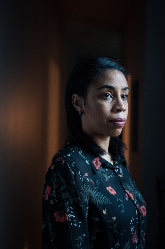 """Ari Curtis poses for a portrait in her Brooklyn home Dec. 29, 2017. Curtis's blog, """"Least Desirable,"""" chronicles her experiences dating as a black woman. Photographed for NPR"""