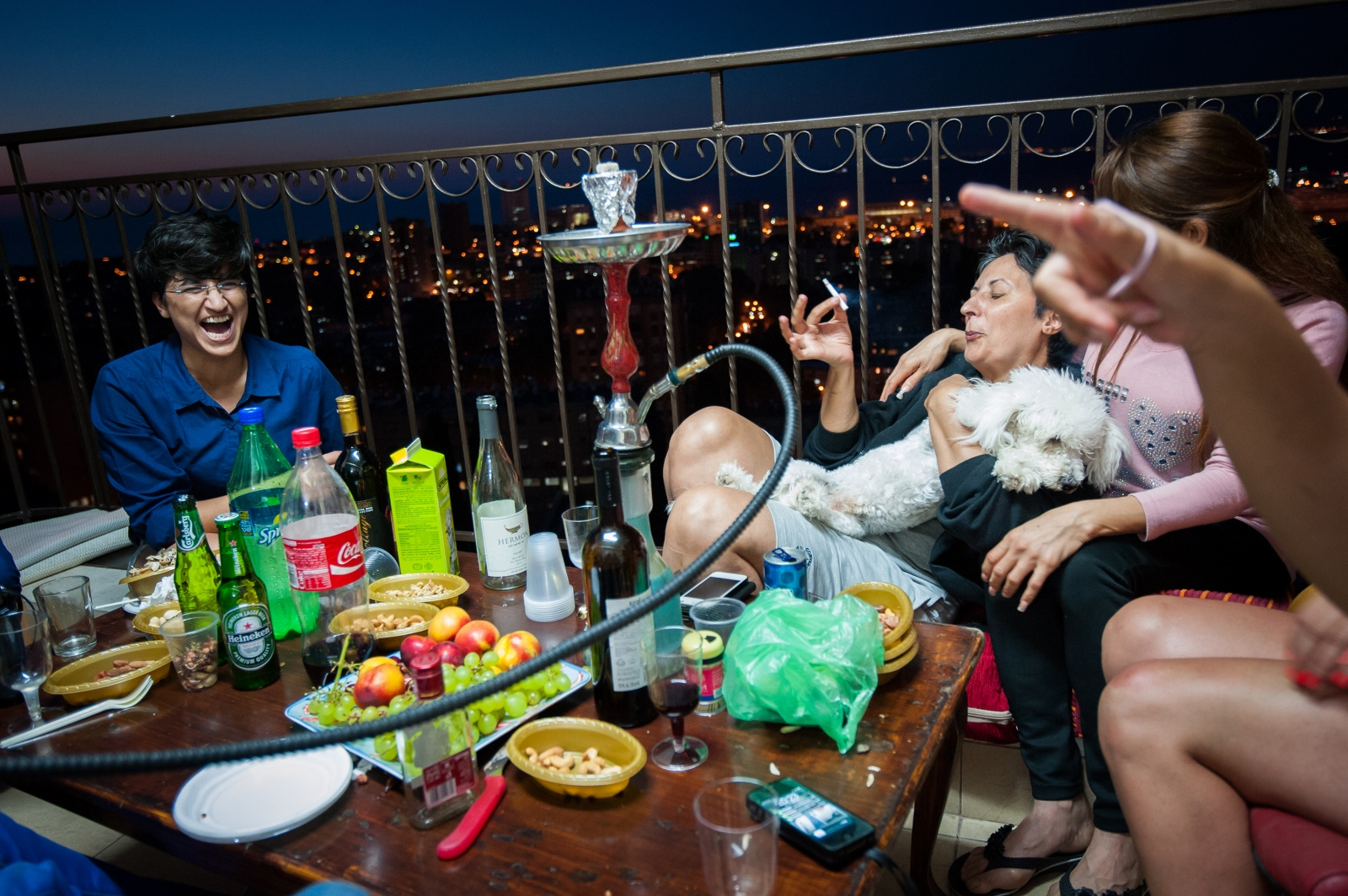 Hasna, who doesn't smoke, is teased by friends and co-workers as she takes a drag of a cigarette. She hosted the group of women at her condo, which overlooks the city. Once the war in Gaza began, Hasna spent less time socializing.