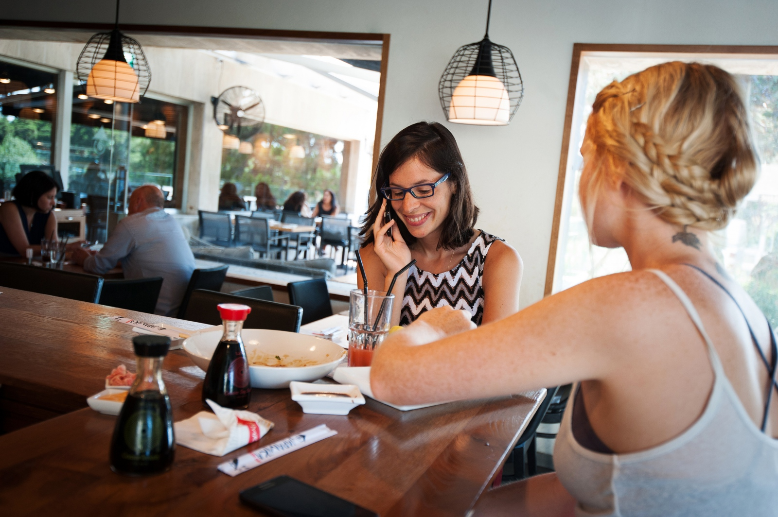 Sapir receives a phone call from her mother while out for sushi with her best friend, Lital, 22. The girls, busy with demanding school schedules, try to find time to catch up on boys, exams and look over pictures of puppies on their phones.