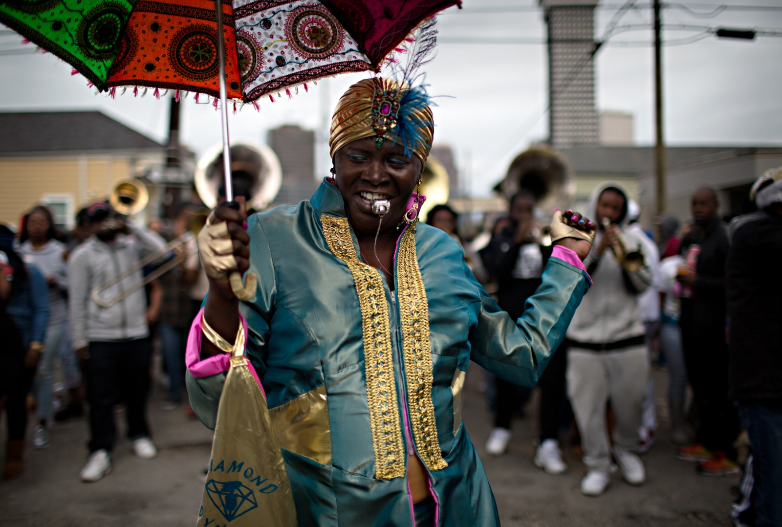 A member of the Diamond Dynasty Social Aid and Pleasure Club leads the brass band as part of the Second Line Parade.