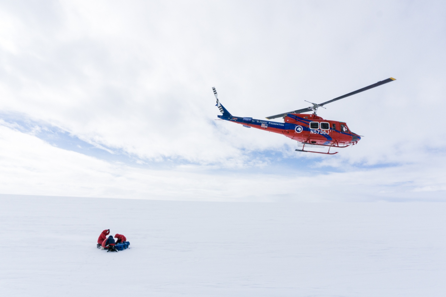 The team gets left by the helicopter for a day's work at McIntyre promontory, roughly a 20 minute flight from Shackleton camp. 11 December 2017.