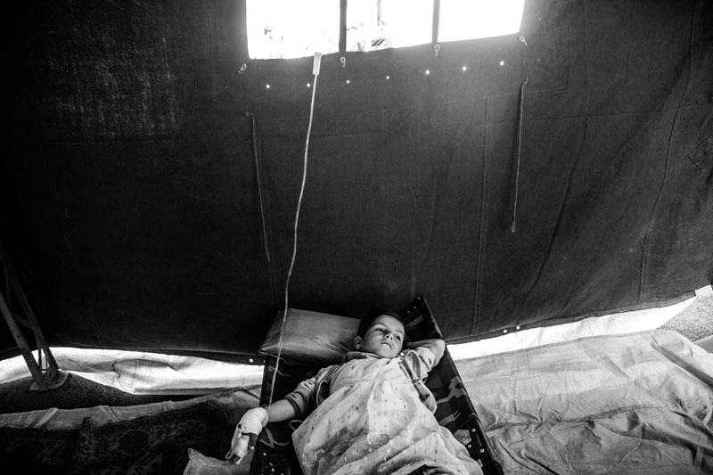 On August 11, 2012, a 6.4-Richter earthquake hit East Azarbaijan province's towns in Northwestern Iran, killing 306 people and wounding over 5,000 others. An injured child is being treated inside the tent of rescue workers.