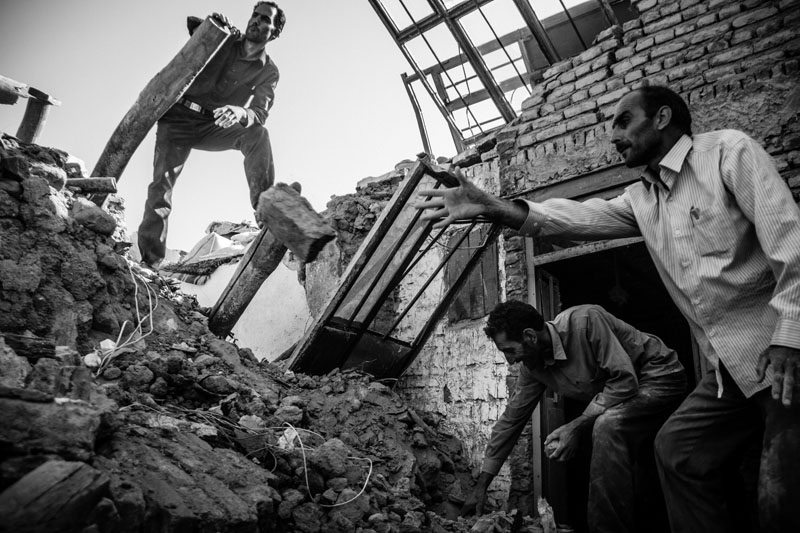On August 11, 2012, a 6.4-Richter earthquake hit East Azarbaijan towns in Northwestern Iran, killing 306 people and wounding over 5,000 others.410 villages were damaged and 65 others were fully destroyed. Men of a family are taking the ruins out with empty hands so that they can save a part of their furniture.