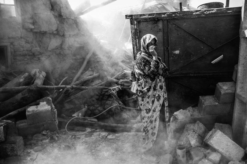 On August 11, 2012, a 6.4-Richter earthquake hit East Azarbaijan towns in Northwestern Iran, killing 306 people and wounding over 5,000 others.410 villages were damaged and 65 others were fully destroyed. Portrait of a woman beside her destroyed house in the village of Quich.