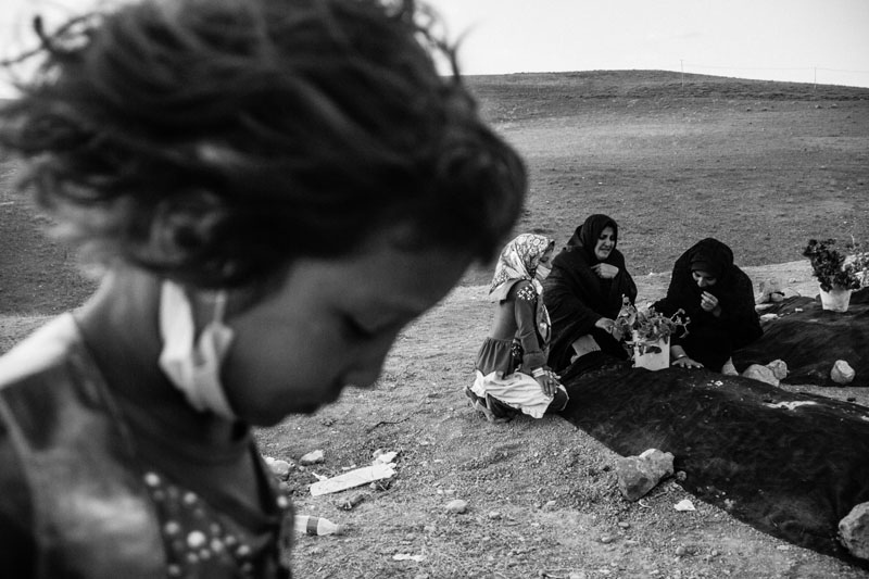 Most of the victims of the 6.4-Richter quake in East Azarbaijan province were residing in Bajeh Baj village. Women are visiting the grave of one of the family members who was killed in the quake .