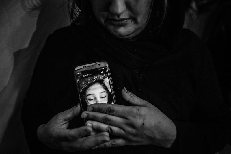 A mother is watching the last image of her 6-year-old daughter who was killed during the 7.3-Richter earthquake in Kermanshah.