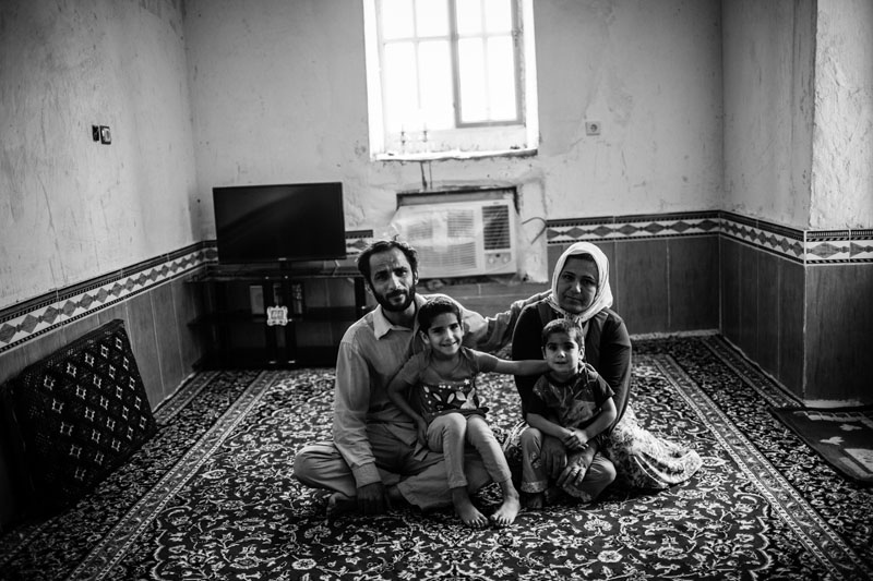 The portrait of a quake-hit family in the town of Shanbeh in Bushehr province who lost their house during the 6.1-Richter earthquake in 2013. They possessed a new house one year after the quake but they sleep inside their conex at nights for the fear of another earthquake.