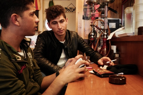Japan, Tokyo, Warabi, 2017. Gokhan and Feti sitting inside Happy Kebab restaurant, in wich kurdish people usually meet here in Warabi. They both have the refugee status Visa that expires every 6 months.