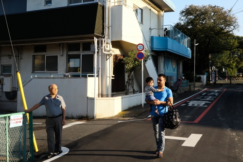 Japan, Tokyo, Warabi, 2017. Yakup Baran,31, during is day-off. He pick up his son Tsubasa, 2, at the kindergarten. He is married with a japanese girl, Ikuko, so he has japanese citizenship.