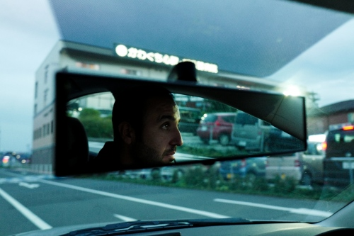 Japan, Tokyo, Warabi, 2017. Kerem Guzel, driving on the streets of Warabi, He works as a truck driver for a Turkish company. He decided to move to Australia, to open a Kebab restaurant, because Japanese society and lifetyle is too different from his personal view.