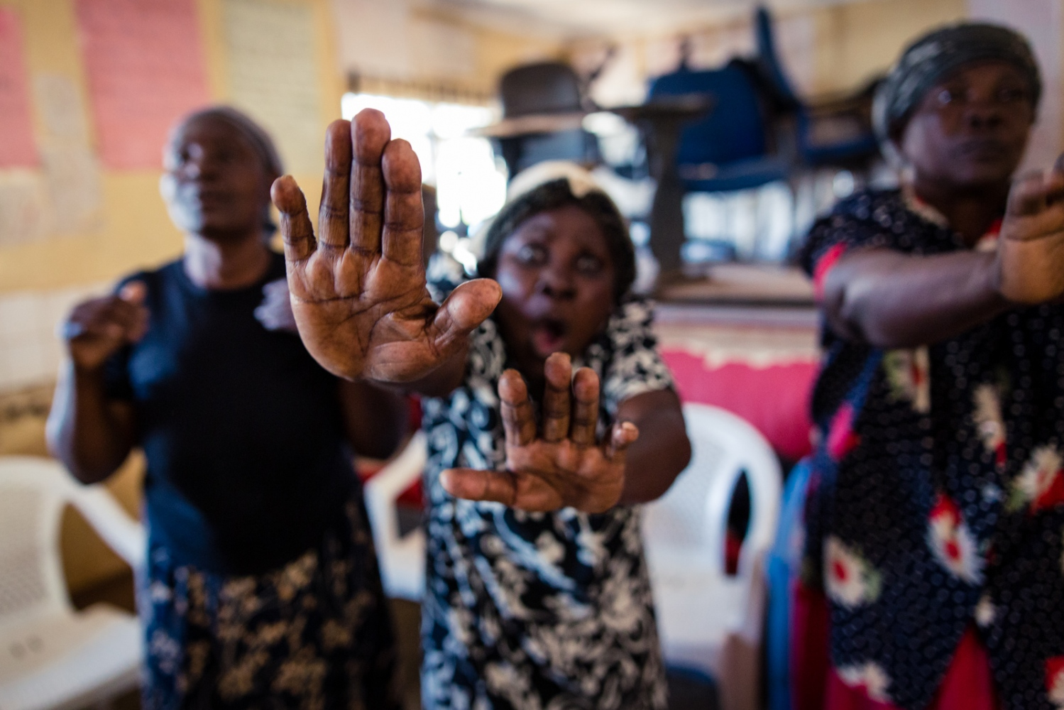 Nairobi, KENYA, March 2, 2017: Flora Masista (C), 64, practices a self-defense technique, whilst screaming 'Nooo!' during a 'Shosho Jikinge' class in the Kibera township. Flora has been training with the other Shoshos for five years and has since applied various tricks she learned: she has escaped potential attackers by lying, tricking and negotiating her way out of dangerous situations.