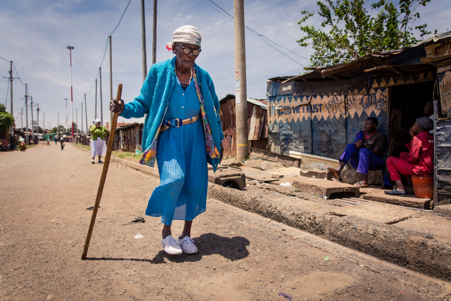 Nairobi, KENYA, February 21, 2017: Helen Wairimu, 106, walks home after a 'Shosho Jikinge' class. In 2016, when she was 105 years old, a heavy-set, young man came to Helen's hut and raped her. Helen still participates in the class every week, eager to encourage the other women to train harder through her role as a survivor.