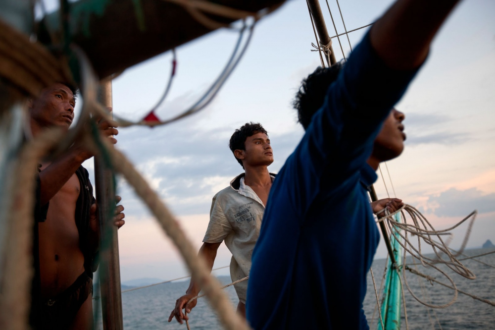 Burmese fishermen set off for a night on a Thai fishing trawler. Thailand is the third largest exporter of fish in the world after China and the US. Its fishing fleet is vast, but years of unregulated trawling has causes incredible damage to fish stocks. Phuket Island, Thailand