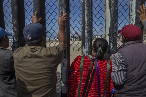 Farmworkers from Mexico's San Quintin valley gather at the border fence to protest against abuses, low pay and poor working conditions on March 29, 2015. After 2 weeks of striking, the farmworkers marched en masse all the way to the border, setting up roadblocks and barricades along the way. The violent demonstrations captured international headlines.