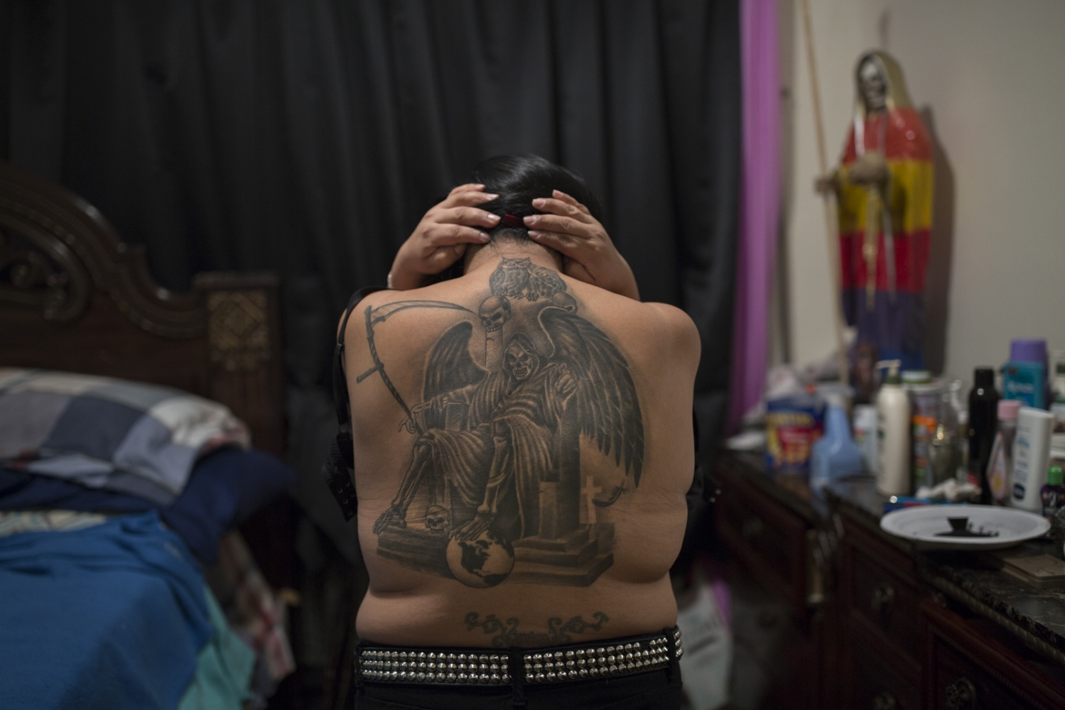 Santa Muerte devotee Rosa Perez shows her unfinished Santa Muerte tattoo. Perez arrived in the U.S. from Mexico 28 years ago and has been a Santa Muerte follower for 10 years.