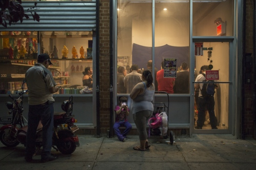 Santa Muerte devotees gather for a monthly rosary at the Botanica La Piadosa store in Queens, New York.