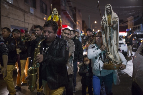 Santa Muerte devotees march in Queens New York, during a Day of the Dead celebration.