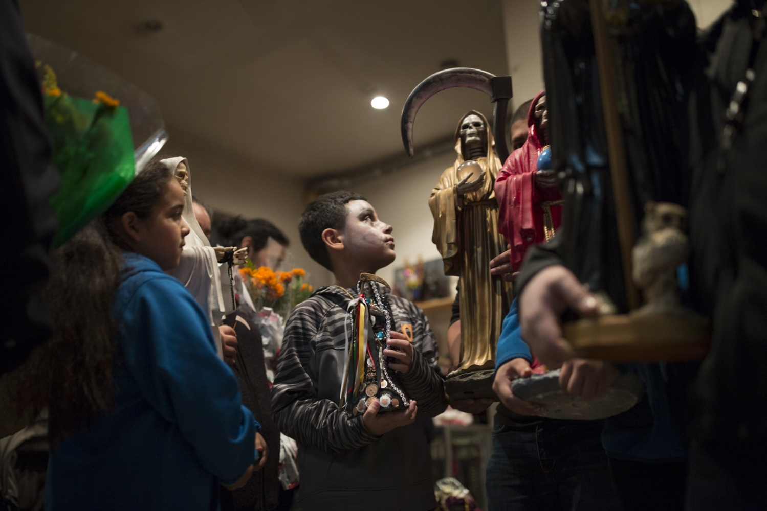 Santa Muerte devotees and their children gather at a botanica in Queens to march in honor of the saint as part of their Day of the Dead annual celebration.