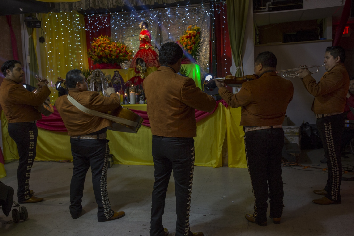 A Mariachi band plays at a party thrown by a Santa Muerte devotee in Queens, New York.