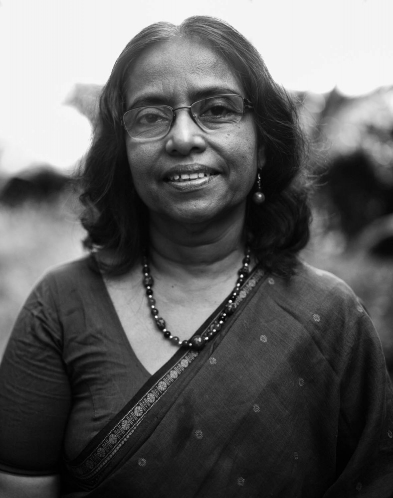 Sitralega Maunaguru.  Co- founder of Suriya Women's Development Centre in Batticaloa, Sri Lanka and lecturer at the Eastern University. SWDC was established in 1991 with the objective of working with women and children displaced by conflict. The photograph was taken in the sitters garden in Batticaloa, April 2012.