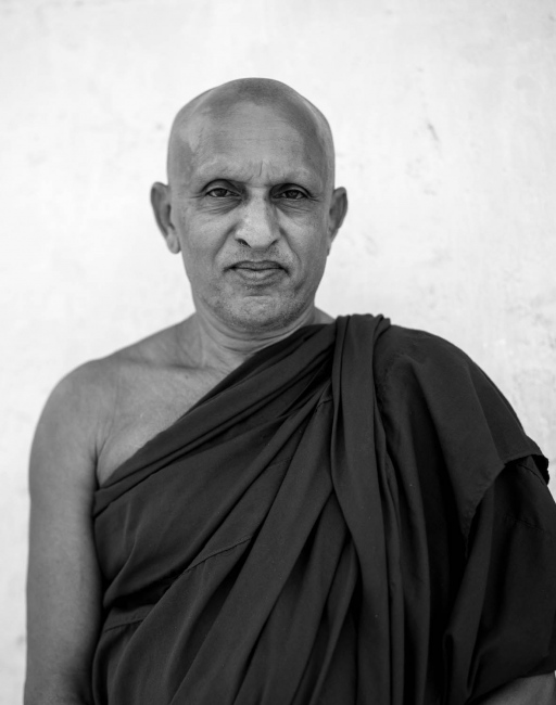 Venerable Buddiyagama Chandraratatana. ABuddhist Priest in Putlam, Sri Lanka who is involved in the support of a language programme to encourage communication between people of different religions. The photograph was taken after a meeting between local religious leaders and The National Peace Council.