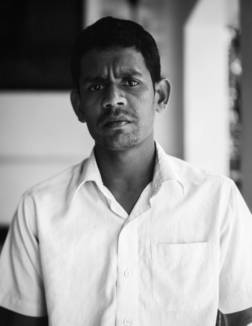 Mr Nirojan, volunteer at one of Nest's community centre's. The photograph was taken on the veranda of the centre in Udadumbara, a small town situated high up in The Knuckles Range in the Central Province.