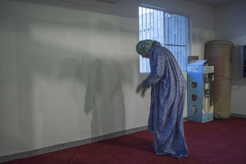 Karina Ureña puts on a sheet to cover her body to pray in the Mosque Omar in Playas de Tijuana, Mexico.