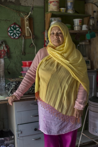 Irma Morales poses for a portrait in her kitchen in Rosarito, Mexico.