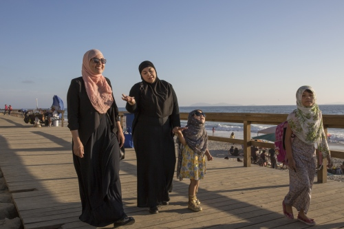 Sisters Ines Valdivia and Zaira Galaviz with her two daughters take a walk in Playas de Tijuana, Mexico, before heading to the mosque for prayer.
