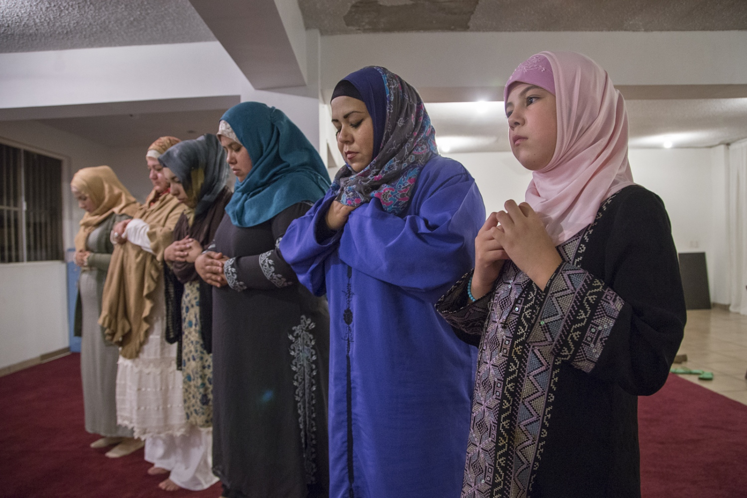 Nahomi castaneda and her mother Fatima pray with other sisters at the Mosque of Omar, in Playas de Tijuana, Mexico.