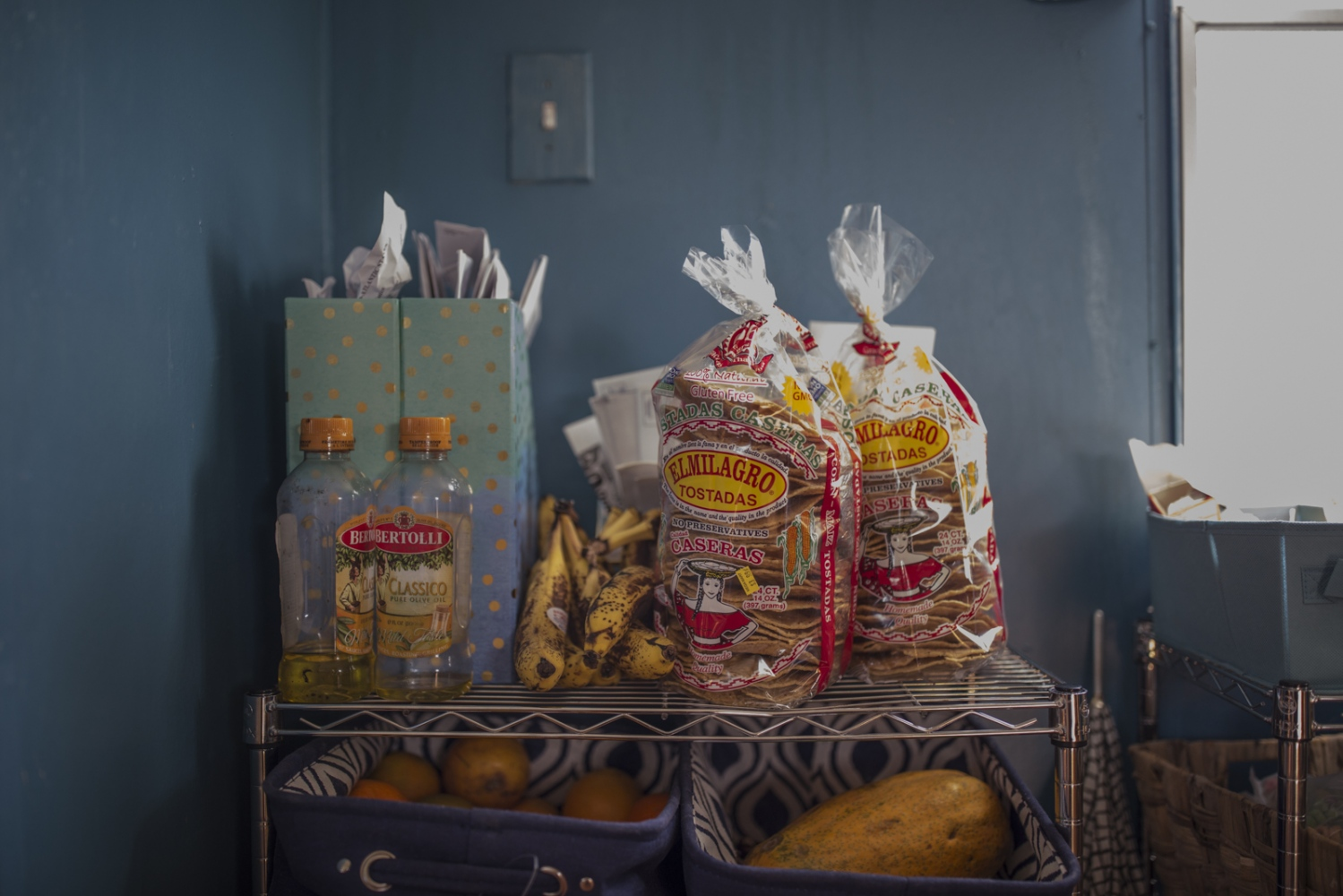 Detail of a corner of the Pineda's family kitchen. Veronica cooks every day for the family, most of the times Mexican dishes such as enchiladas and pozole.