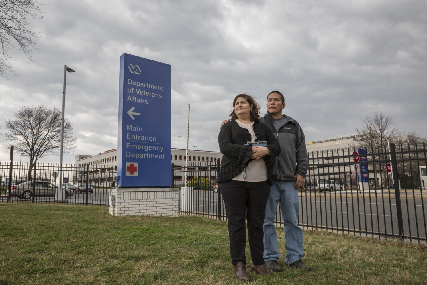 Army veteran Ricardo Pineda and his wife Veronica Castro stand outside a V.A. hospital just before Ricardo's appointment in Washington D.C. Pineda's appointments at the V.A. hospital are frequent and Veronica always goes with him.
