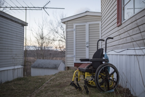 Juan Pablo Pineda's old wheelchair outside the family house in Lothian, MD. Juan Pablo has brain damage resulting from complications during a heart surgery when he was three years old and was unable to walk for over 7 years.
