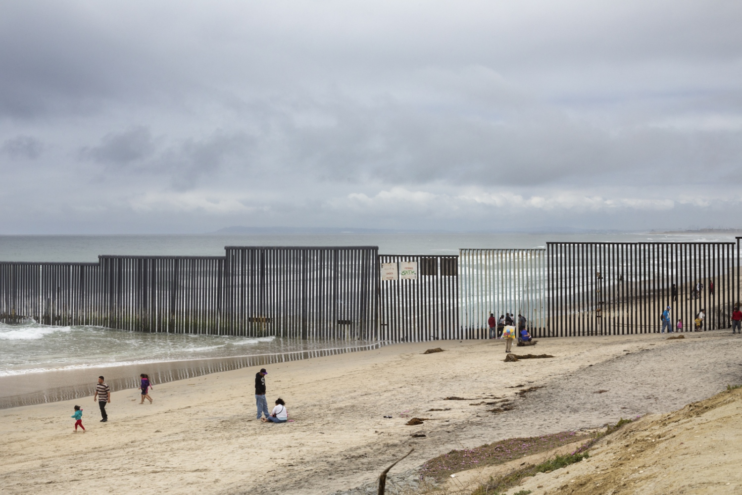 The border between Tijuana and San Diego is today a massive metal wall that has been reinforced multiple times since the 1990s. It extends down to the beach stretching out some three hundred feet into the Pacific Ocean.