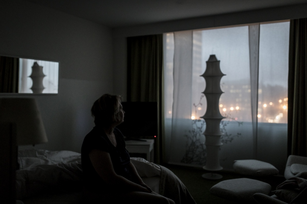 Photography image - Room with a view. Nathalie, early morning in Brussels, Belgium on January 22th, 2018. © Valentin Bianchi
