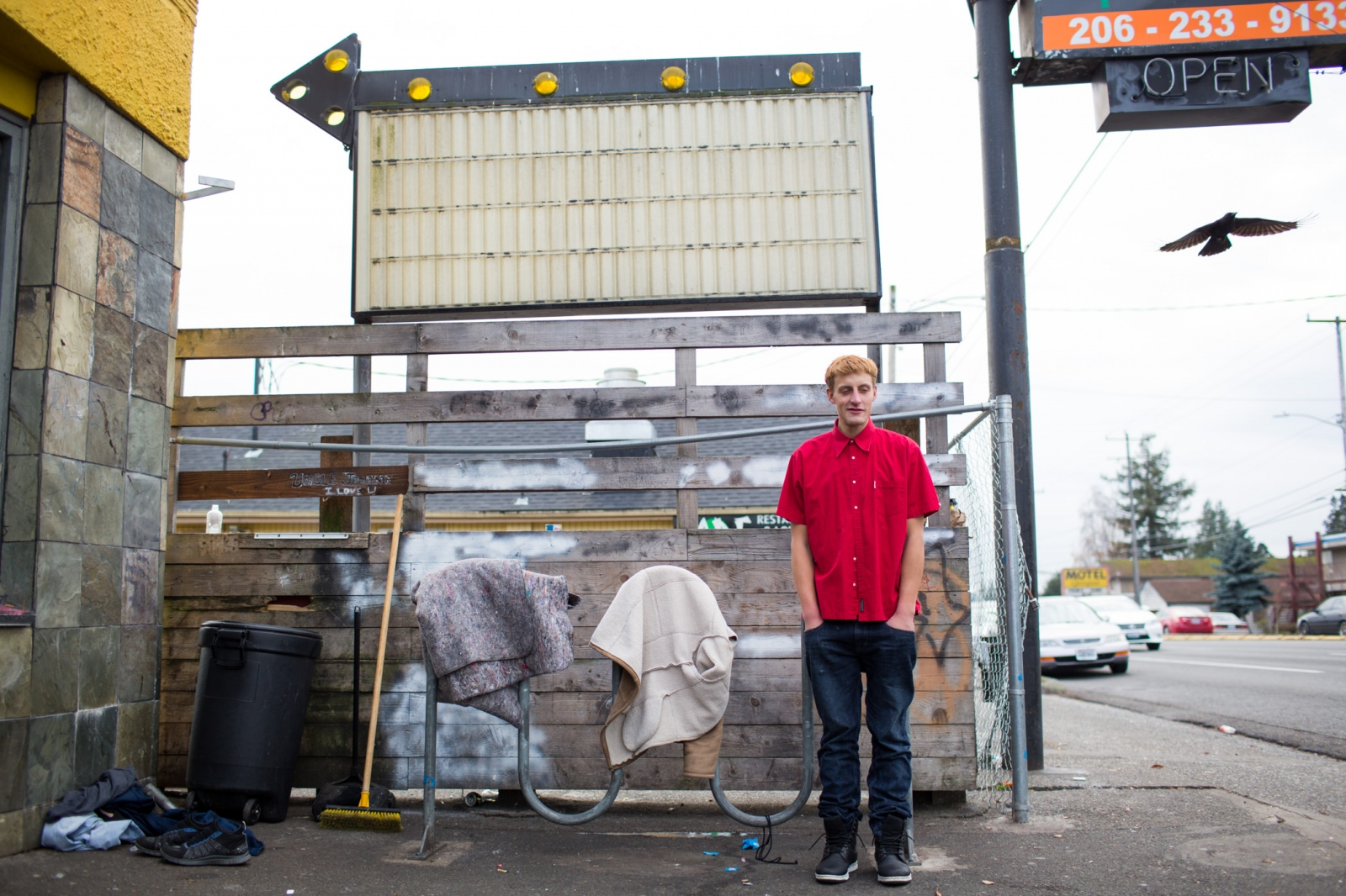 """David """"Wolf"""" Wickinstad, 30, outside Aurora Commons, a homeless community center and open kitchen for the homeless in Seattle. 'Homeless at Christmas' for the Guardian"""