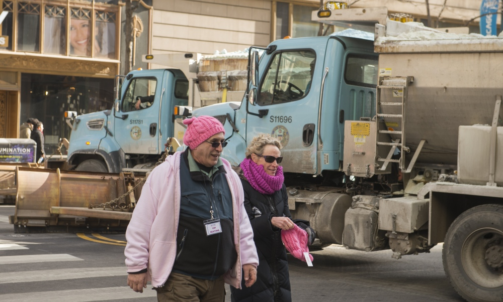 Photography image - A Couple leaves the Chicago 2018 Women's march. Salt trucks Block State Street.