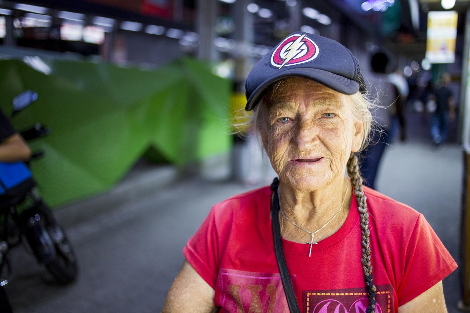Aracely, an elder street vendor in Medellin,...