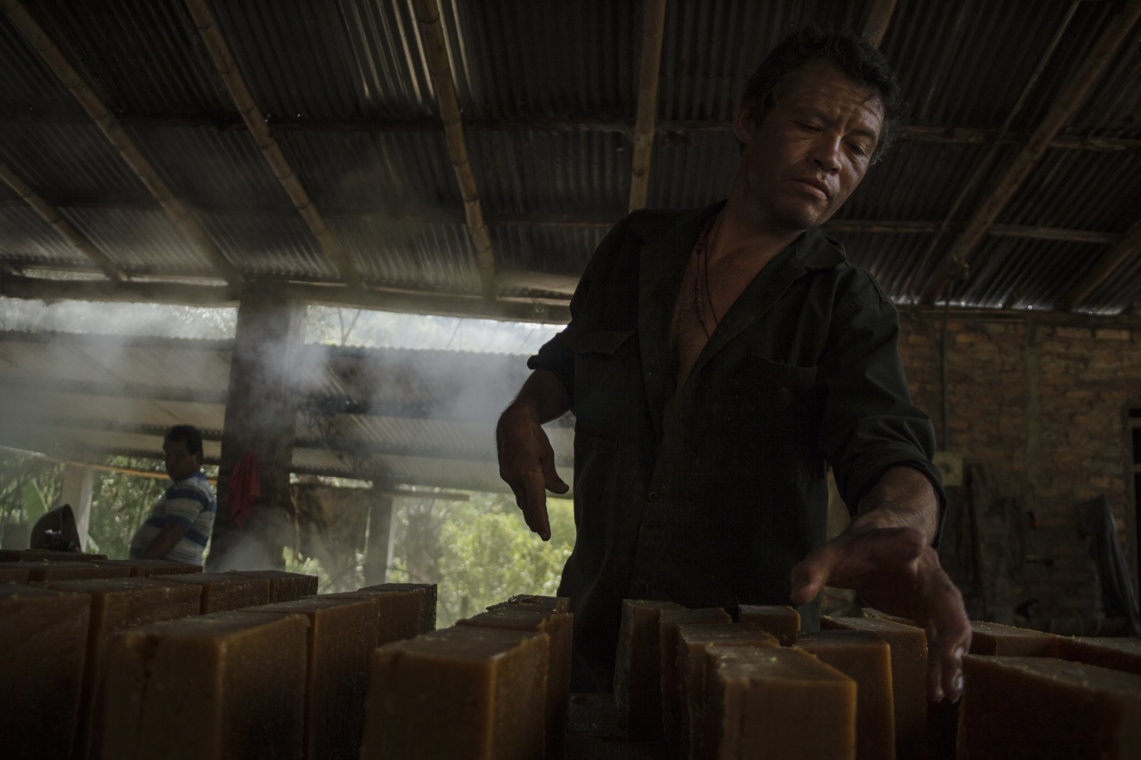 Don Ricardo, who is in charge of the panela molds, told me how almost a month ago he lost a finger in one of the mills where he also works. This shows the hard way that the panela, La Virgen and its people have to take to get the aguapanela drinken by the Colombians. (2016)