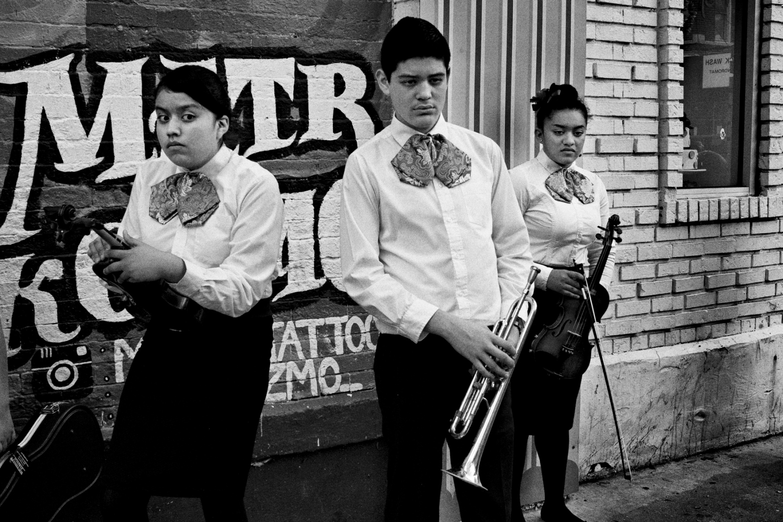 During the Mole de Mayo Festival in the Pilsen neighborhood of Chicago, young mariachi players perform between Lucha matches. Pilsen has been an immigrant community for over 150 years. Originally mainly composed on Eastern Europeans, it later became home to a majority Latino immigrants. This lower east side neighborhood is going through a gentrification and many families are being now displaced or priced out of their homes.